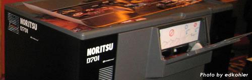 写真処理機器の「ノーリツ鋼機」が希望退職による200名の削減へ